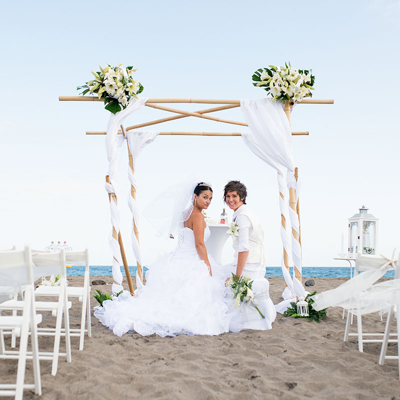 Family Enjoying Time Together On Beautiful Foggy Beach: Stunning Same Sex Beach Wedding With Bamboo Set-Up In Tenerife